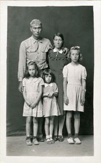 untitled [army man with arm around woman's shoulder, with three little girls] by mike disfarmer